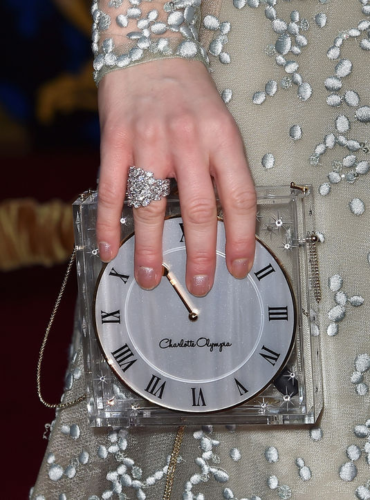 lily-james-cinderella-premiere-charlotte-olympia-clock-clutch-h724.jpg