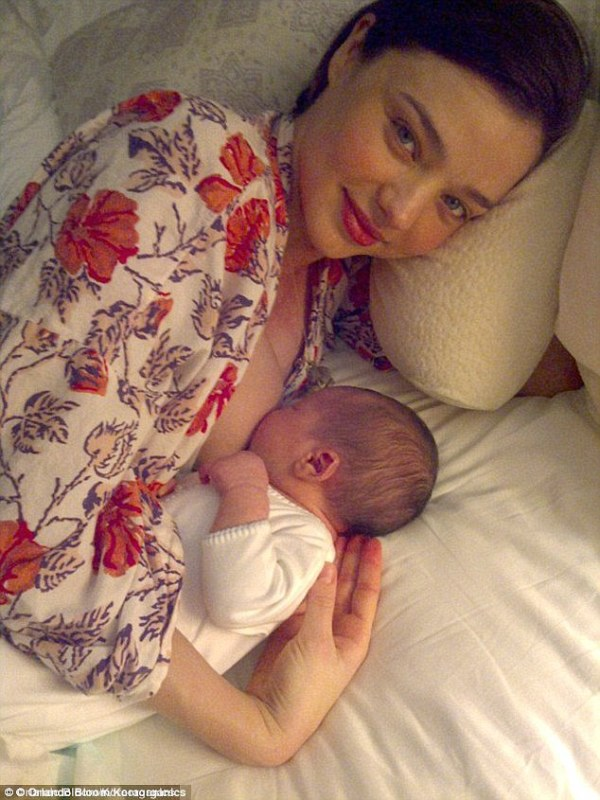 Miranda Kerr breastfeeding adorable baby Flynn just days after his birth.  Photo Credit: Daily Mail
