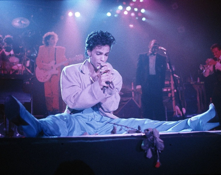 Prince in heels at Wembley Arena, London, 1986. Image Credit: Michael Putland/Getty Images.