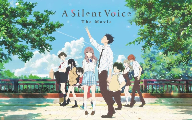 Madman Entertainment Poster for A Silent Voice. Characters are in a line moving closer to the scree in the centre, where Shōya is reaching up towards the title. The background is set outdoors with trees on each side and gravel ground.